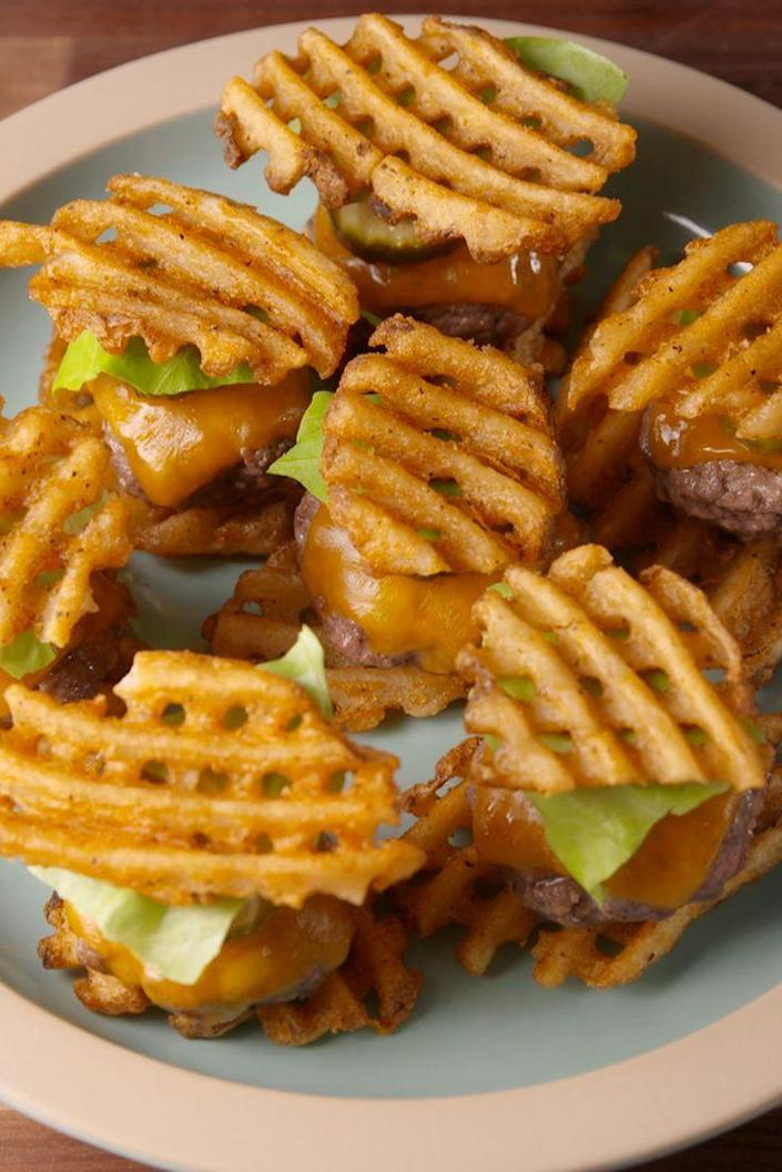 "<p>Fries and burgers in one adorable bite—it's about time.</p><p>Get the recipe from <a href=""https://www.delish.com/cooking/recipes/a48885/waffle-fry-sliders-recipe/"" rel=""nofollow noopener"" target=""_blank"" data-ylk=""slk:Delish"" class=""link rapid-noclick-resp"">Delish</a>.</p>"