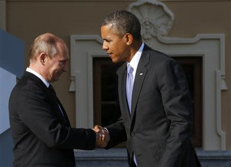 Russia's President Putin welcomes U.S. President Obama before the first working session of the G20 Summit in Constantine Palace in Strelna near St. Petersburg
