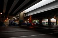 Tents are placed under an expressway ahead of Hurricane Ida, in New Orleans