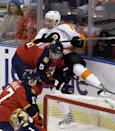 Philadelphia Flyers center Brayden Schenn (10) is checked by Florida Panthers defenseman Aaron Ekblad (5) in the first period of an NHL hockey game in Sunrise, Fla., Saturday, Nov. 1, 2014. (AP Photo/Alan Diaz)
