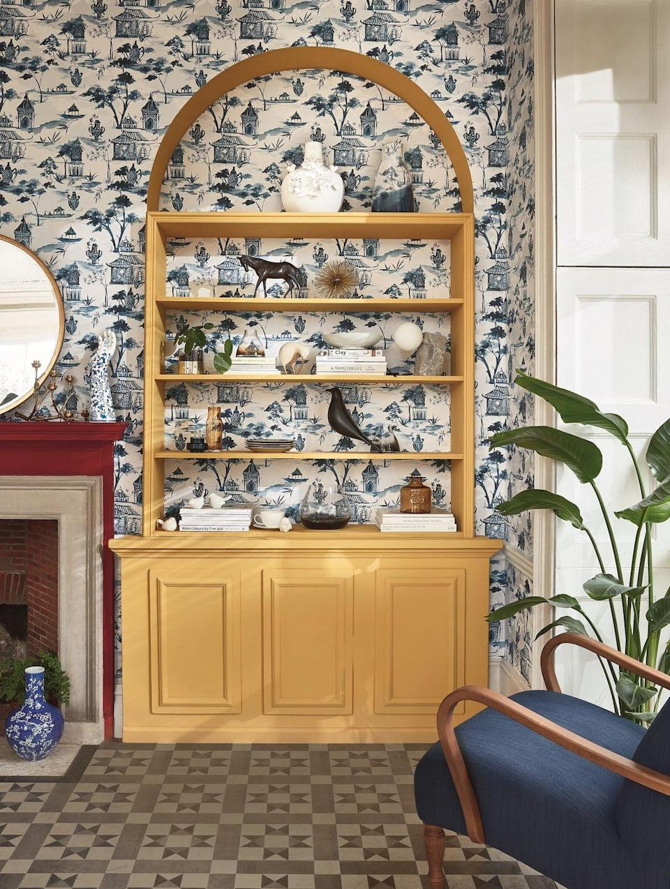 """<p>Make a feature of bespoke furniture in your living room by using patterned wallpaper to accentuate its design and features. This charming wallpaper print wonderfully adds so much extra detail, giving the bookcase within the arched alcove an extra dimension beyond its artfully styled shelves.</p><p>Pictured: Shop the Heritage Revival trend at <a href=""""https://go.redirectingat.com?id=127X1599956&url=https%3A%2F%2Fwww.johnlewis.com%2Fsearch%3Fsearch-term%3Dheritage%2Brevival&sref=https%3A%2F%2Fwww.housebeautiful.com%2Fuk%2Fdecorate%2Fliving-room%2Fg35838996%2Fliving-room-wallpaper-ideas%2F"""" rel=""""nofollow noopener"""" target=""""_blank"""" data-ylk=""""slk:John Lewis & Partners"""" class=""""link rapid-noclick-resp"""">John Lewis & Partners</a></p>"""