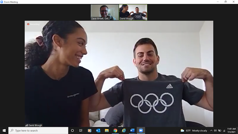 Melissa Gonzalez, left, and Lions quarterback David Blough talk after Gonzalez qualified to compete in track and field in the Tokyo Olympics for Colombia.