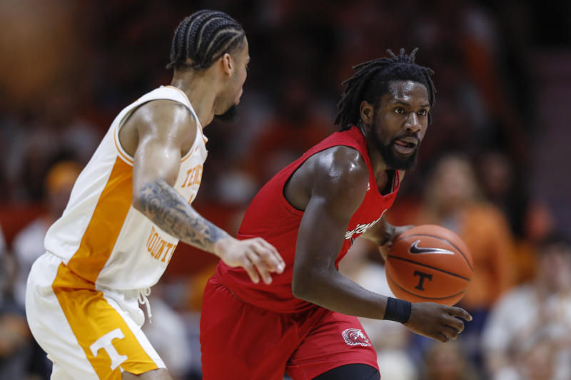 Jacksonville State guard Ty Hudson (4) drives against Tennessee guard Lamonte Turner (1) during the second half of an NCAA college basketball game Saturday, Dec. 21, 2019, in Knoxville, Tenn. Tennessee won 75-53. (AP Photo/Wade Payne)