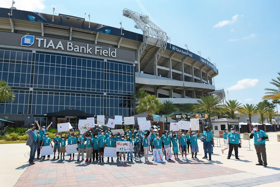Third grade students from Long Branch Elementary School taking part in the Jaguars Goalsetter program wait for the arrival of Jaguars first round draft pick Trevor Lawrence to arrive at TIAA Bank Field Friday. The Jacksonville Jaguars' first-round draft pick Trevor Lawrence and his wife Marissa Mowry arrived at TIAA Bank Field in Jacksonville, Florida about noon Friday, April 30, 2021. The couple was greeted by team owner Shad Khan and 35 third-grade students from Long Branch Elementary School.
