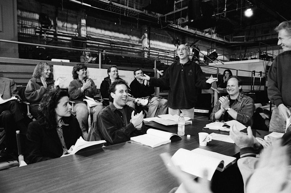 <p>David addresses the cast and crew in this behind-the-scenes photo, which gives an intimate glimpse at one of <em>Seinfeld</em>'s table reads. </p>