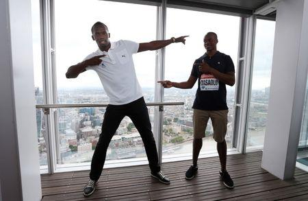 Athletics - Usain Bolt visits the Shard ahead of the Sainsbury's Anniversary Games - The Shard, London - 25/7/13  Jamaica's Usain Bolt and Great Britain's James Dasaolu (R) visit the Shard ahead of the Sainsbury's Anniversary Games  Mandatory Credit: Action Images / Steven Paston  Livepic