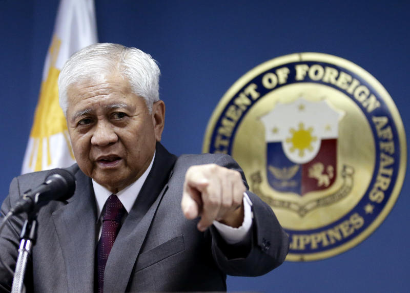 """Philippine Foreign Affairs Secretary Albert Del Rosario talks about three big issues involving the Philippines, including the presence of the Philippine contingent to the UN peacekeeping forces at the Golan Heights during a news conference Wednesday June 19, 2013 in Manila, Philippines. Del Rosario said the Philippines still is committed to keep the Philippine peacekeepers until August 3, 2013 and subject to """"conditionalities"""" beyond the period. (AP Photo/Bullit Marquez)"""