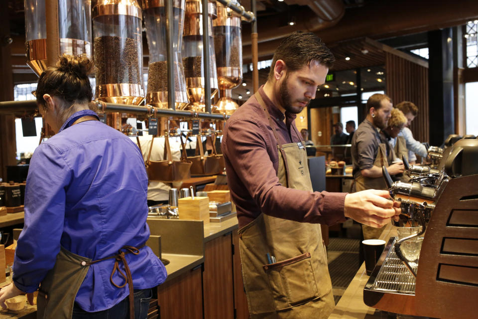 Starbucks baristas prepare drinks during a preview of its new Reserve Roastery and Tasting Room in Seattle, Washington December 4, 2014.   REUTERS/Jason Redmond  (UNITED STATES - Tags: BUSINESS FOOD)