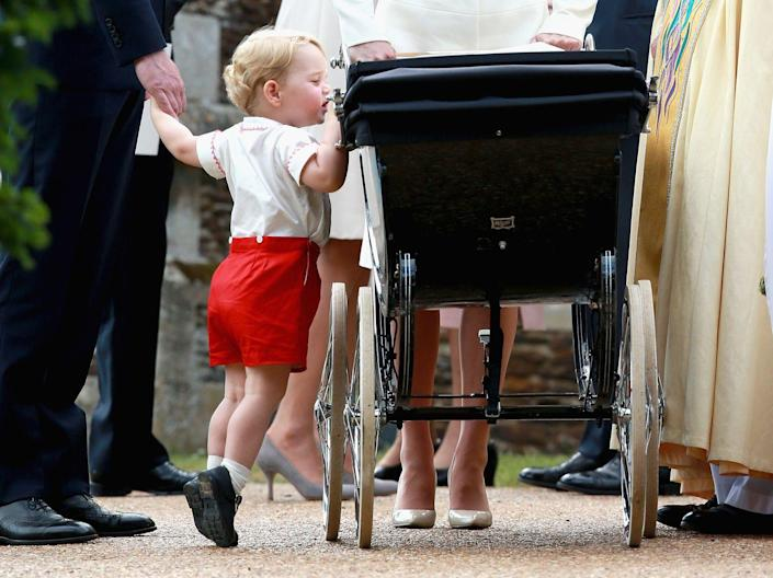 """<p>Checking in on his <a href=""""https://www.townandcountrymag.com/society/tradition/news/a3773/princess-charlotte-dress-one/"""" rel=""""nofollow noopener"""" target=""""_blank"""" data-ylk=""""slk:baby sister at her christening"""" class=""""link rapid-noclick-resp"""">baby sister at her christening</a>.</p>"""