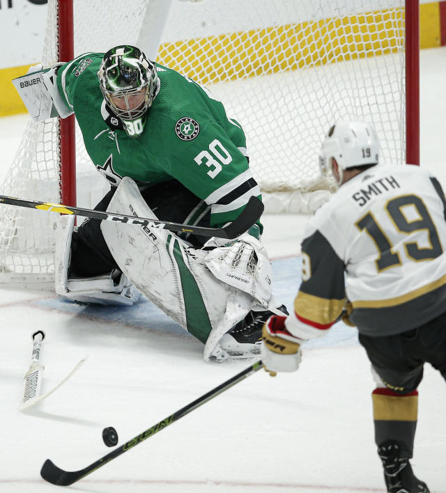 Vegas Golden Knights forward Reilly Smith (19) attempts a shot as Dallas Stars goaltender Ben Bishop (30) defends during the second period of an NHL hockey game Friday, Dec. 13, 2019, in Dallas. (AP Photo/Brandon Wade)