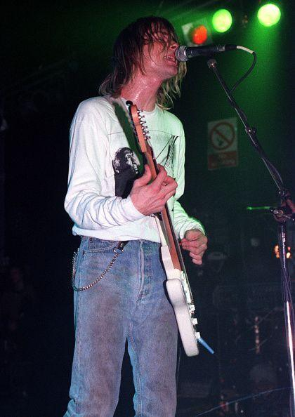 """<p>Kurt Cobain performs on stage at the Astoria Theatre in London on November 5, 1991. Before the success of """"Smells Like Teen Spirit,"""" Cobain was frustrated by the band's small crowds and difficulty sustaining themselves while touring. </p>"""