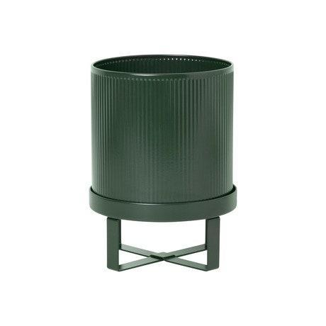 """This ridged, powder-coated steel pot and accompanying plant stand comes in three earthy colors and a slightly larger size. $55, 2Modern. <a href=""""https://www.2modern.com/products/bau-pot"""" rel=""""nofollow noopener"""" target=""""_blank"""" data-ylk=""""slk:Get it now!"""" class=""""link rapid-noclick-resp"""">Get it now!</a>"""