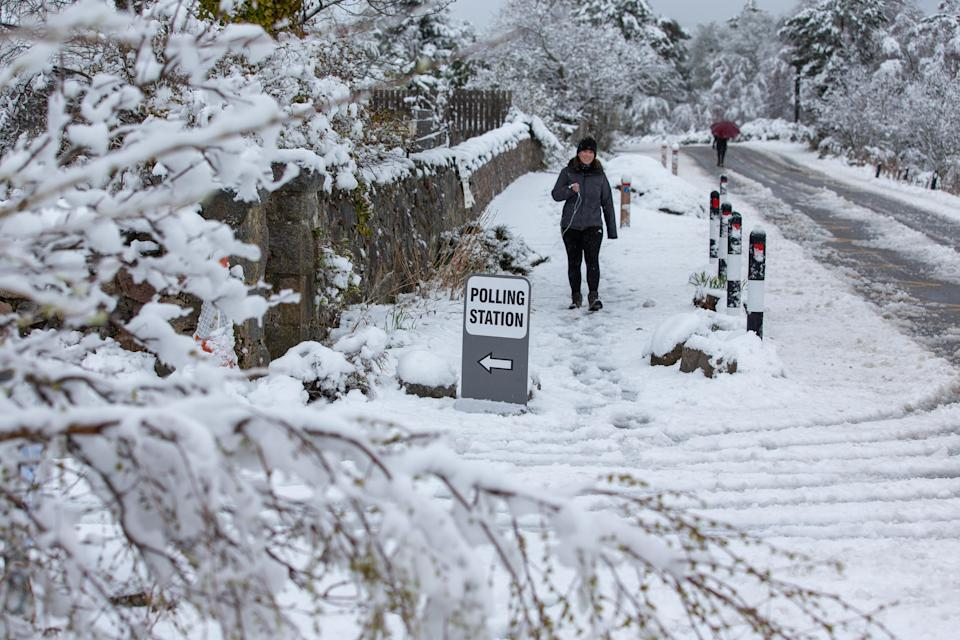 Snowy conditions at a Scottish Parliamentary election polling station in the village of Farr, near Inverness (Paul Campbell/PA)