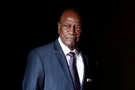 FILE PHOTO: Guinea's President Alpha Conde arrives to attend a visit and a dinner at the Orsay Museum in Paris