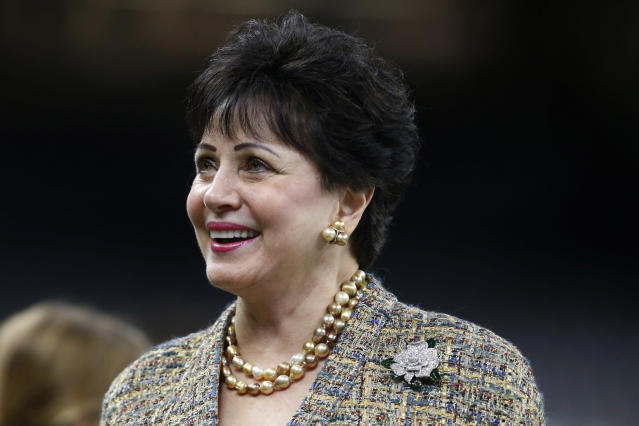FILE - In this Nov. 24, 2019, file photo, New Orleans Saints owner Gayle Benson watches the team warm up, before an NFL football game against the Carolina Panthers in New Orleans. An Associated Press review of public tax documents found that the Bensons' foundation has given at least $62 million to the Archdiocese of New Orleans and other Catholic causes over the past dozen years, including gifts to schools, universities, charities and individual parishes. (AP Photo/Butch Dill, File)