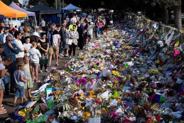 PHOTO: Floral tributes to those who were gunned down at the two mosques are seen against a wall bordering the Botanical Garden in Christchurch on March 19, 2019. (Marty Melville/AFP/Getty Images)