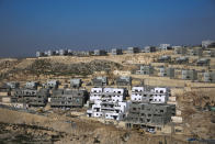 FILE - This Tuesday, Jan. 1, 2019, file photo, shows a new housing project in the West Bank settlement of Naale. Peter Beinart, an influential American commentator, has shocked the Jewish establishment and Washington policy-making circles by breaking a long-standing taboo: He has endorsed the idea of a democratic entity of Jews and Palestinians living with equal rights between the Jordan River and the Mediterranean. (AP Photo/Ariel Schalit, File)