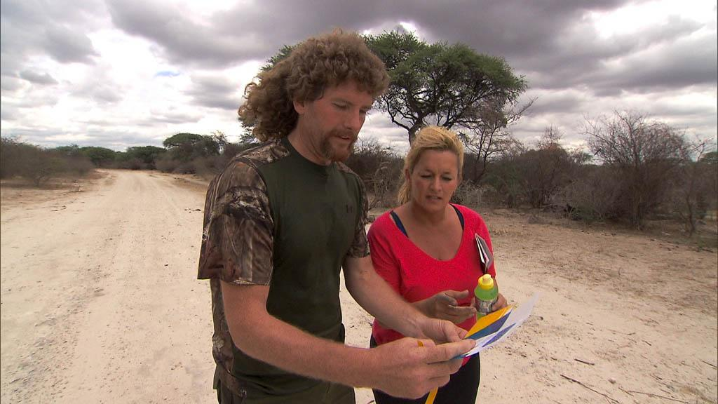 """Scorpion King Hunter"" -- At the Detour Decision Point, Married couple Chuck (left) and Wynona (right) must choose between Detour A ""Fire"" or Detour B ""Fowl"" in the Kalahari Desert on ""The Amazing Race."""