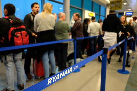 Passengers prepare to board a Ryanair flight at Stansted Airport, Britain, October 12, 2017. Picture taken October 12, 2017 REUTERS/Hannah McKay