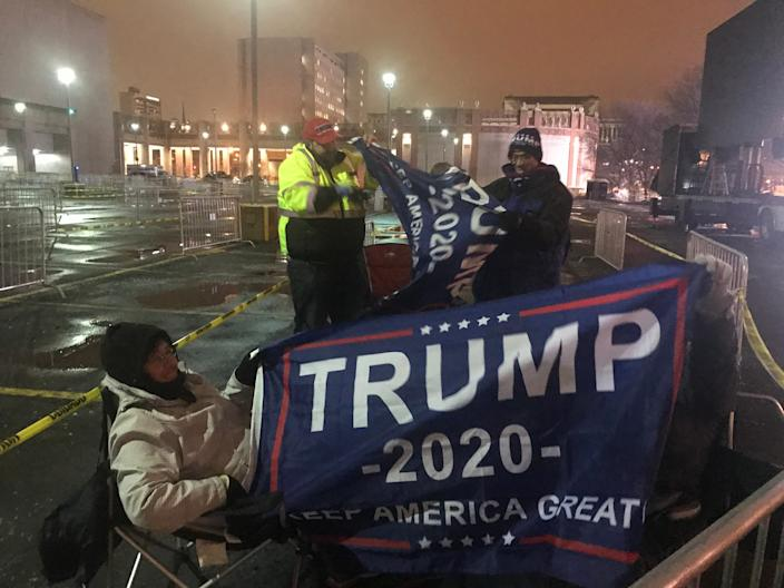 Elizabeth Sorenson, left, and her sister-in-law Linda Sorenson, behind flag, were the first in line for President Donald Trump's campaign rally. They set up their chairs at 4:30 p.m. Monday in the parking lot across from the UW-Milwaukee Panther Arena. Doors open at 3 p.m. Tuesday for the 7 p.m. rally.