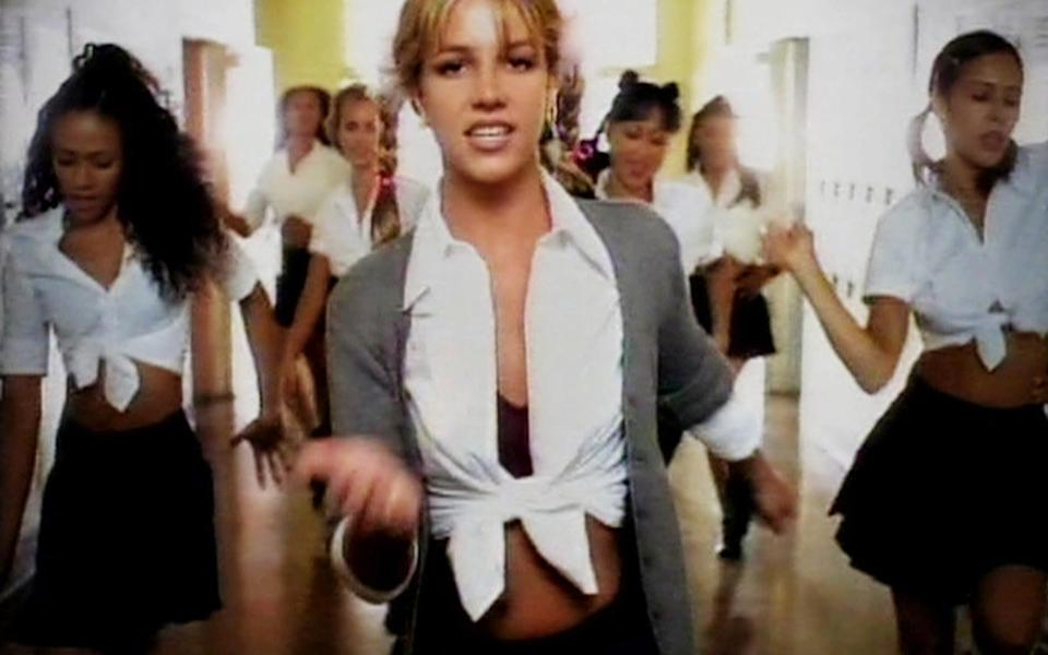 Britney Spears in the video for Hit Me Baby, One More Time - PA
