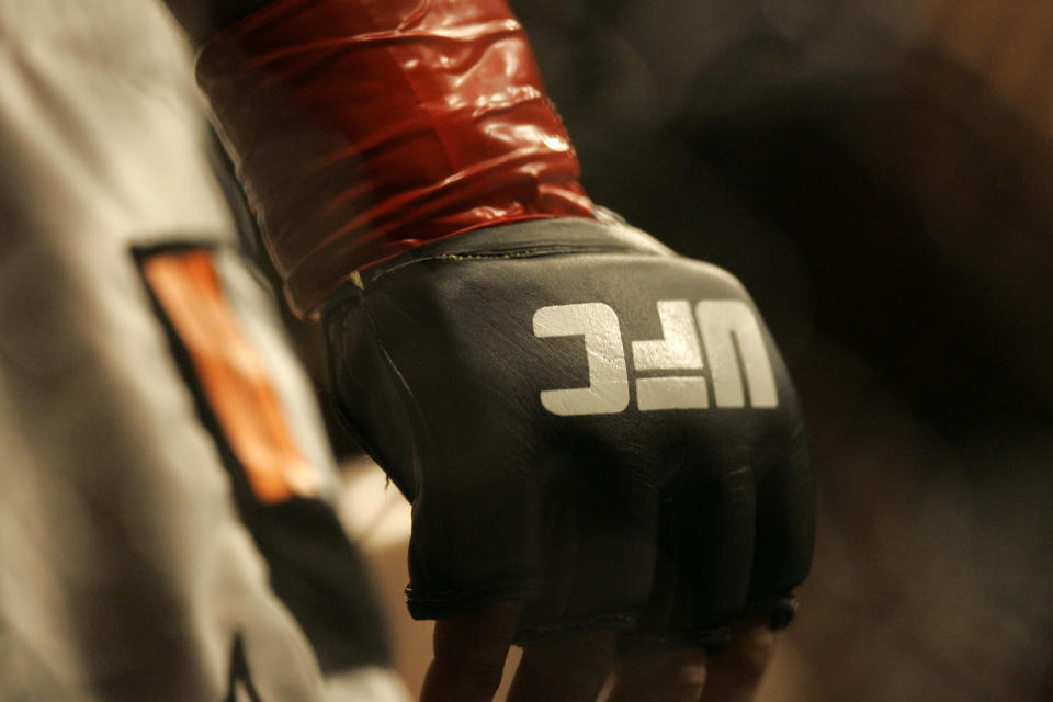 Closeup of a glove and the UFC logo at Ultimate Fighting Championship 73 on Saturday, July 7, 2007, in Sacramento, Calif.  (AP Photo/Jeff Chiu)