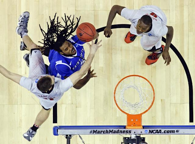 Saint Louis guard Jordair Jett gets past Louisville's Luke Hancock, left, and guard Terry Rozier for a basket during the second half of a third-round game in the NCAA college basketball tournament in Orlando, Fla., Saturday, March 22, 2014. (AP Photo/John Raoux)
