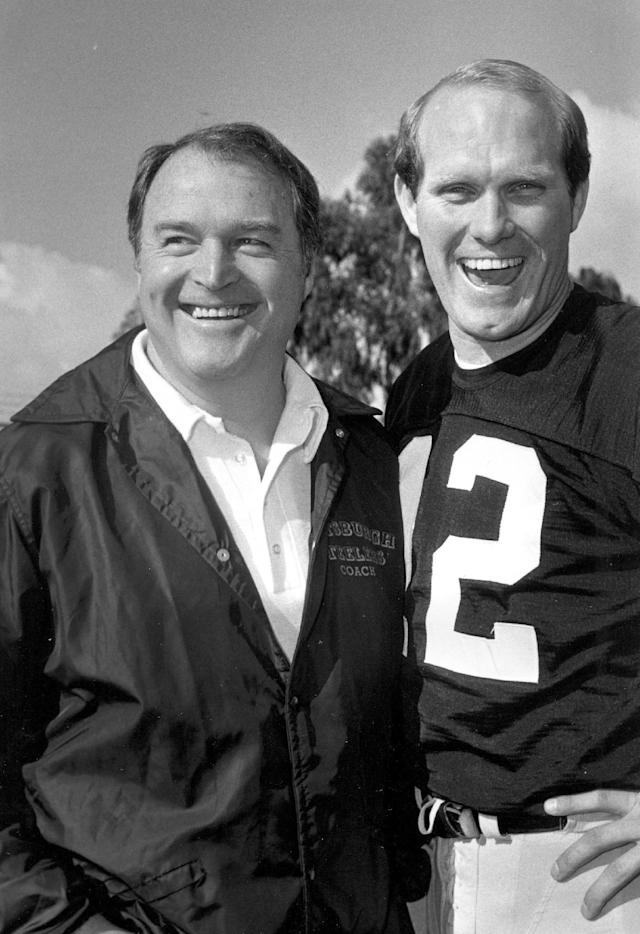 FILE - In this January 1980, file photo, Pittsburgh Steelers coach Chuck Noll, left, and quarterback Terry Bradshaw smile on picture day for the NFL football Super Bowl, in Fullerton, Calif. Noll, the Hall of Fame coach who won a record four Super Bowl titles with the Steelers, died Friday night, June 13, 2014, at his home. He was 82. The Allegheny County (Pa.) Medical Examiner said Noll died of natural causes. (AP Photo/File)