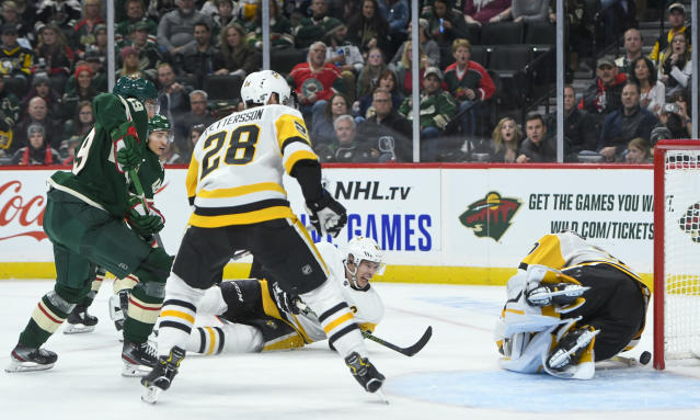 Minnesota Wild center Victor Rask scores on a shot past Pittsburgh Penguins goalie Matt Murray, right, as Penguins defenseman Marcus Pettersson (28) and center Sidney Crosby, second from right, look on during the second period of an NHL hockey game Saturday, Oct. 12, 2019, in St. Paul, Minn. (AP Photo/Craig Lassig)