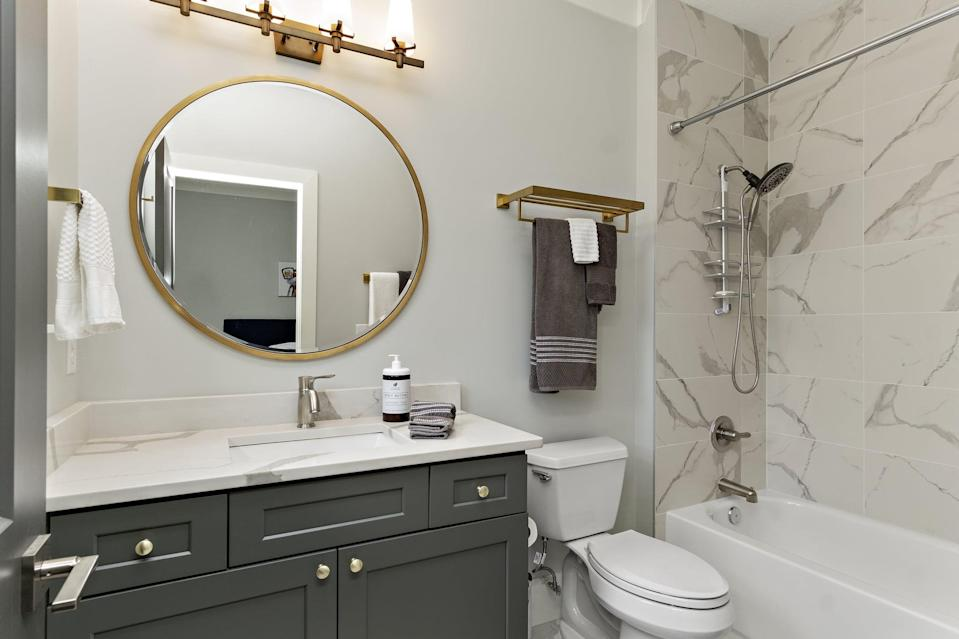 <ul> <li>Disinfect shower, bathtub, toilet, sink, faucets, countertops, and any other high-touch surfaces</li> <li>Clean mirrors</li> <li>Clean inside and outside of medicine and vanity cabinets; then reorganize (toss out any expired products like makeup, medication, etc., and hair tools that no longer work like curling iron, straightener, blow dryer, etc.)</li> <li>Wash any rugs or bath mats</li> <li>Dust, sweep, and mop floors</li> </ul>