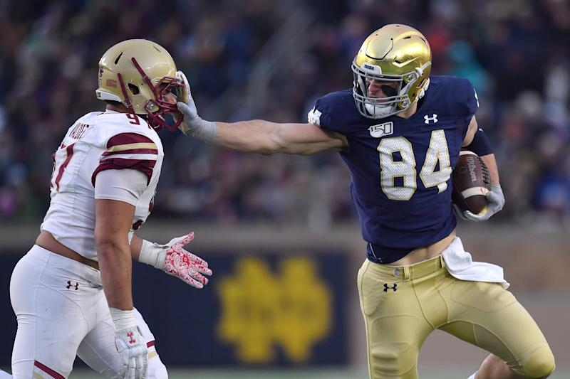 Notre Dame TE Cole Kmet stiff-arms a Boston College defender. (Photo by Robin Alam/Icon Sportswire via Getty Images)