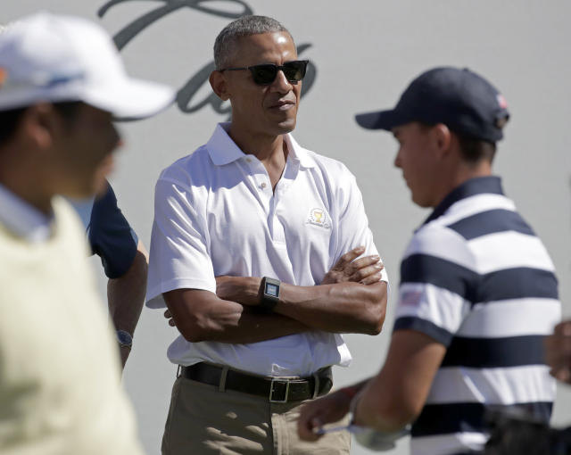 <p>Former President Barack Obama looks on from the first tee before the first round of the Presidents Cup at Liberty National Golf Club in Jersey City, N.J., Thursday, Sept. 28, 2017. (AP Photo/Julio Cortez) </p>