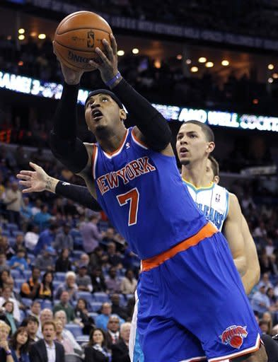 New York Knicks forward Carmelo Anthony (7) drives to the basket ahead of New Orleans Hornets guard Austin Rivers during the first half of an NBA basketball game in New Orleans, Tuesday, Nov. 20, 2012. (AP Photo/Gerald Herbert)