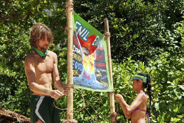 """Blindside Time"" - Erik Reichenbach and Brenda Lowe hang up their new tribe flag during the eighth episode of ""Survivor: Caramoan - Fans vs. Favorites."""