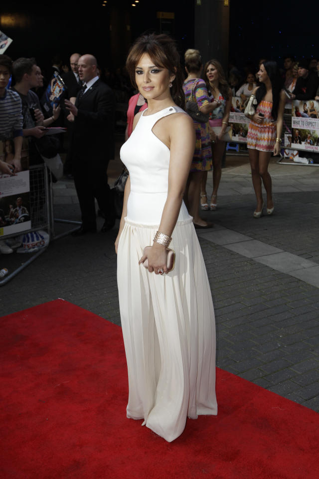 British singer Cheryl Cole poses for photographers as she arrives for the European premiere of the movie 'What to Expect When You're Expecting' at a cinema in London, Tuesday, May 22, 2012. (AP Photo/Matt Dunham)