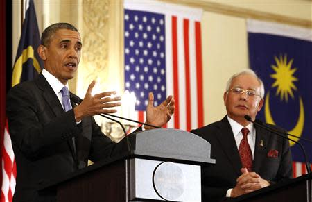 U.S. President Obama speaks next to Malaysian PM Razak during joint news conference at Perdana Putra Building in Putrajaya