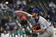Los Angeles Dodgers starting pitcher Trevor Bauer throws during the first inning of a baseball game against the Milwaukee Brewers Thursday, April 29, 2021, in Milwaukee. (AP Photo/Morry Gash)