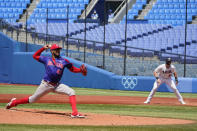 Dominican Republic's Denyi Reyes (41) pitches against the United States in a baseball game at the 2020 Summer Olympics, Wednesday, Aug. 4, 2021, in Yokohama, Japan. (AP Photo/Sue Ogrocki)