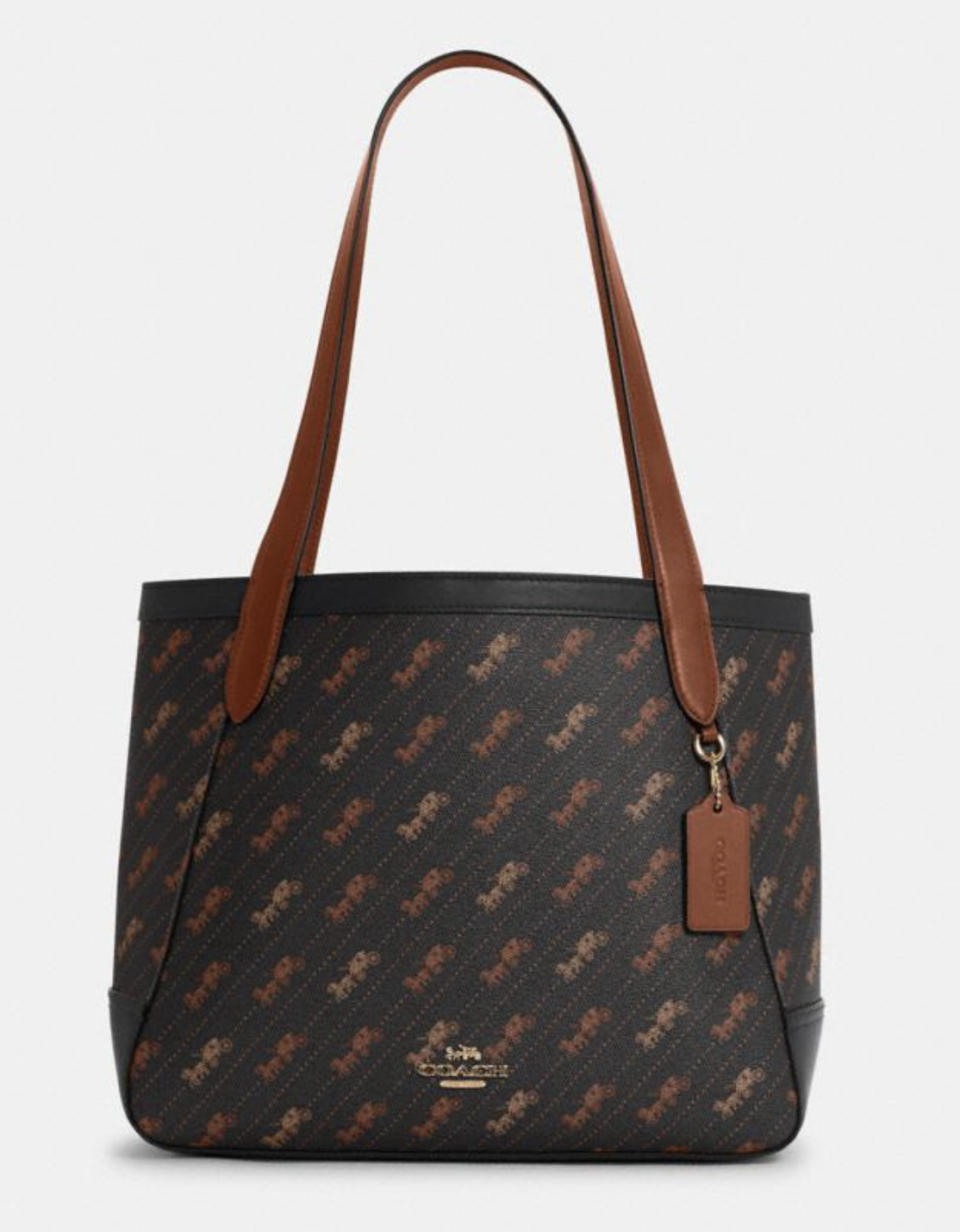 Horse And Carriage Tote in Horse and Carriage Dot Print in Black (Photo via Coach Outlet)
