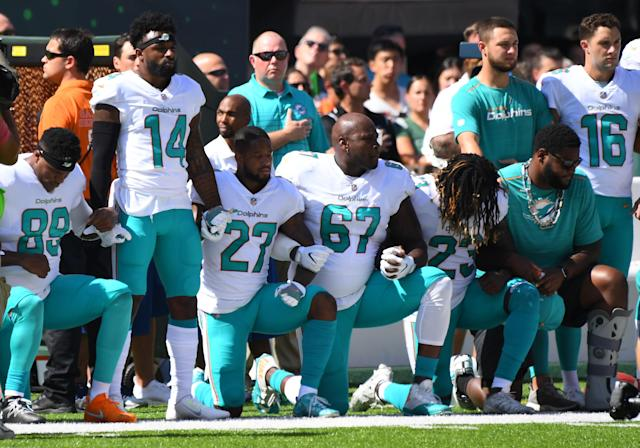 <p>Some of the Miami Dolphins take a knee during the anthem prior to the game against the New York Jets at MetLife Stadium. Mandatory Credit: Robert Deutsch-USA TODAY Sports </p>