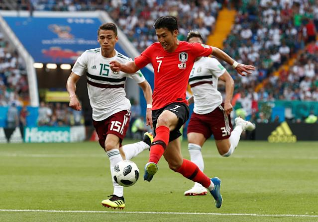 Soccer Football - World Cup - Group F - South Korea vs Mexico - Rostov Arena, Rostov-on-Don, Russia - June 23, 2018 South Korea's Son Heung-min in action with Mexico's Hector Moreno REUTERS/Damir Sagolj