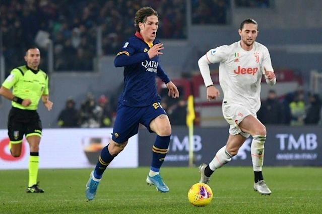 AS Roma's Italian midfielder Nicolo Zaniolo (C) looks set to miss Euro 2020. (AFP Photo/Andreas SOLARO)