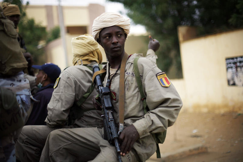 Chadian soldiers patrol the streets of Gao, Northern Mali, Monday Jan. 28, 2013. Malian soldiers descended on the city of Timbuktu on Monday after al-Qaida-linked militants fled into the desert having set ablaze a library that held thousands of ancient manuscripts. (AP Photo/Jerome Delay)