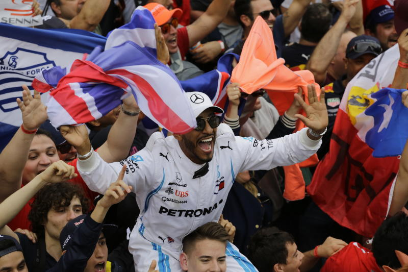 A fan dressed as Mercedes driver Lewis Hamilton, of Britain, cheers after the Brazilian Formula One Grand Prix at the Interlagos race track in Sao Paulo, Brazil, Sunday, Nov. 11, 2018. Five-time world champion Lewis Hamilton won the race helping his team to take the constructors' title. (AP Photo/Nelson Antoine)