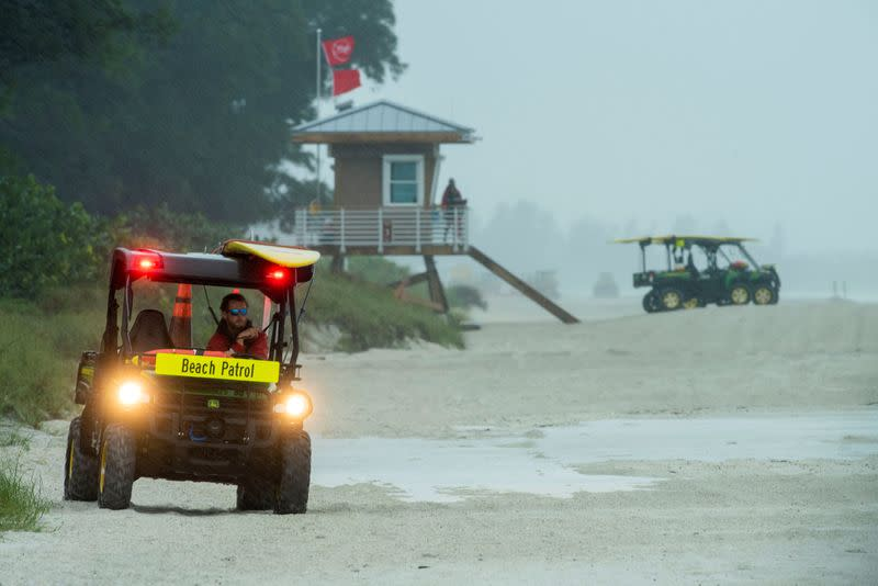 FILE PHOTO: Lifeguards patrol the shore under double red flags after closing the beach to swimmers before the arrival of Tropical Storm Eta in Bradenton Beach