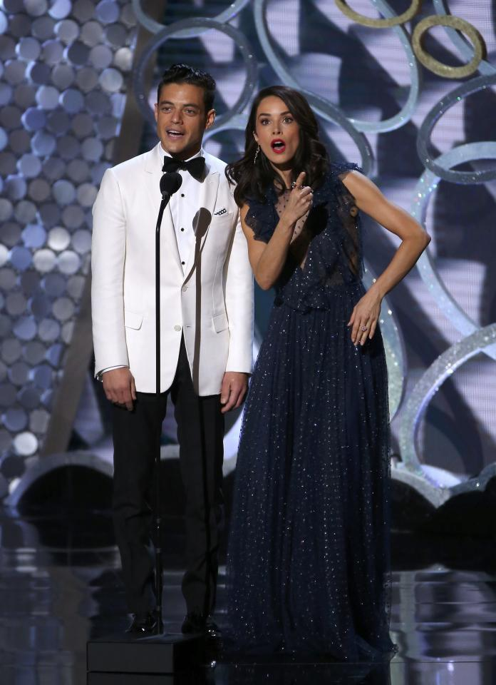 Rami Malek and Abigail Spencer present an award at the 68th Primetime Emmy Awards in Los Angeles, California, U.S., September 18, 2016.  REUTERS/Mike Blake