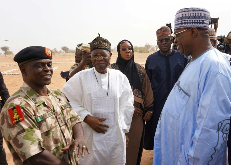 Yobe state governor Ibrahim Gaidam (right) conferred Thursday with Information Minister Lai Mohammed and the head of the military force fighting Boko Haram, Brigadier General Rogers Nicholas, outside the school the girls attended