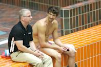 <p>Phelps has had coach Bob Bowman by his side since he was seven years old. Over the years, the pair trained together for the Olympics, and are pictured here chatting on Day 2 of the Canada Cup — an event Phelps went on to win yet another gold medal at. </p>
