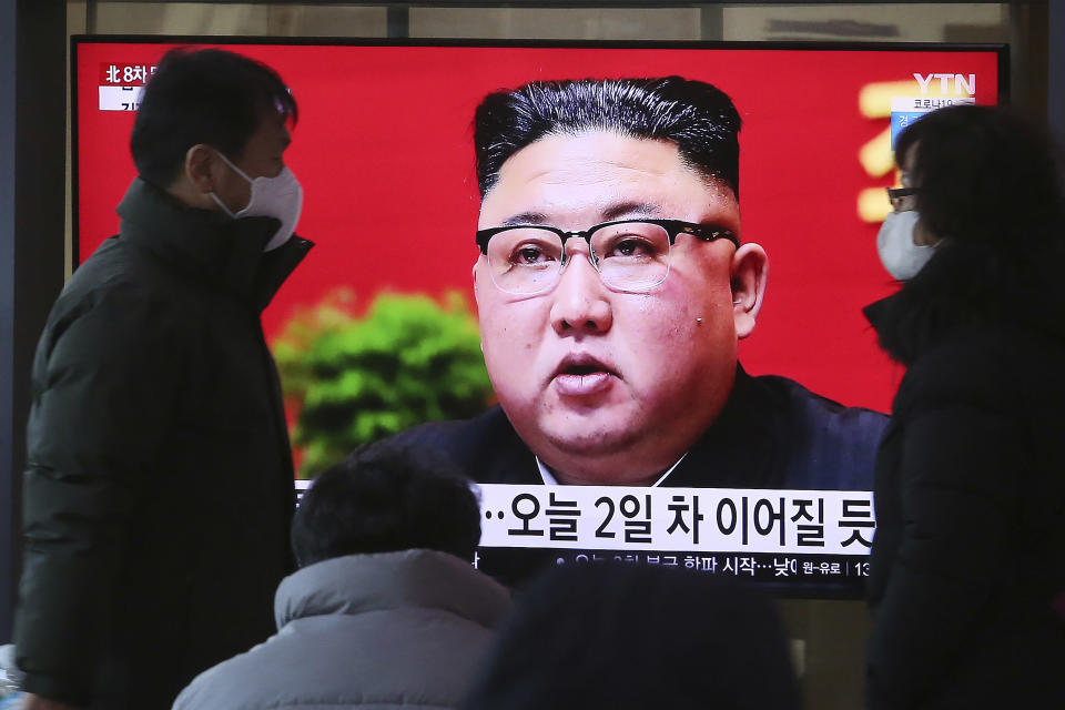 People walk by a TV screen showing North Korean leader Kim Jong Un during a ruling party congress, at the Seoul Railway Station in Seoul, South Korea, Wednesday, Jan. 6, 2021. Kim opened his country's first ruling party congress in five years with an admission of policy failures and a vow to set new developmental goals, state media reported Wednesday. (AP Photo/Ahn Young-joon)