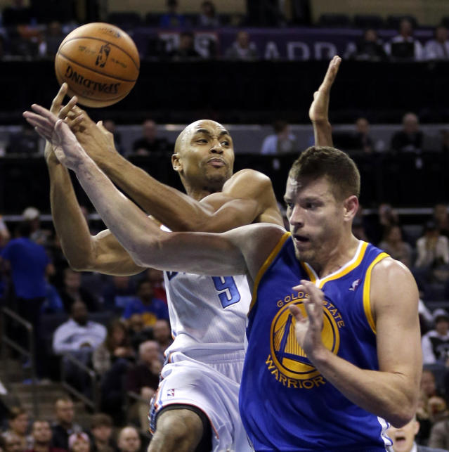 Charlotte Bobcats' Gerald Henderson, left, is fouled by Golden State Warriors' David Lee, right, during the first half of an NBA basketball game in Charlotte, N.C., Monday, Dec. 9, 2013. (AP Photo/Chuck Burton)